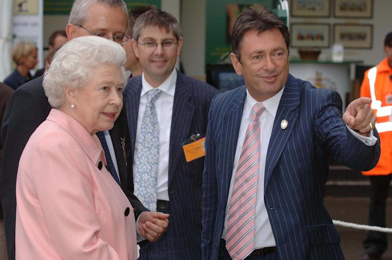HM Queen Elizabeth II chats with Alan Titmarsh when she visits the RHS Chelsea Flower Show in London on May 21, 2007. (Photo by Anwar Hussein Collection/ROTA/FilmMagic)
