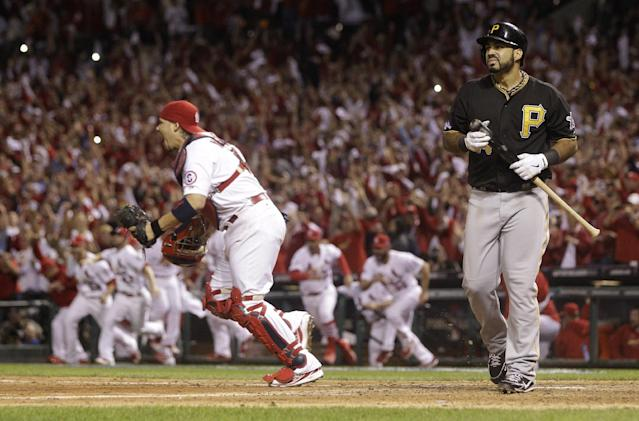 Pittsburgh Pirates' Pedro Alvarez walks off the field after striking out for the final out of Game 5 of a National League baseball division series against the St. Louis Cardinals, Wednesday, Oct. 9, 2013, in St. Louis. The Cardinals won 6-1, and advanced to the NL championship series against the Los Angeles Dodgers. (AP Photo/Charlie Riedel)