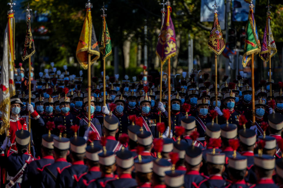 Royal Guards attend a military parade as they celebrate 'Dia de la Hispanidad' or Hispanic Day in Madrid, Spain, Tuesday, Oct. 12, 2021. Spain commemorates Christopher Columbus' arrival in the New World and also Spain's armed forces day. (AP Photo/Manu Fernandez)