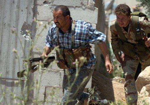 "Members of the Free Syrian Army's ""Freedom for the River Assi Brigade"" run as they take part in an attack"