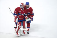 Montreal Canadiens goaltender Carey Price and teammate Phillip Danault skate off the ice following the team's to the Tampa Bay Lightning in Game 3 of the NHL hockey Stanley Cup Final, Friday, July 2, 2021, in Montreal. (Paul Chiasson/The Canadian Press via AP)