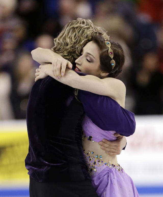 Meryl Davis and Charlie White hug after skating during the ice dance free skate at the U.S. Figure Skating Championships Saturday, Jan. 11, 2014 in Boston. (AP Photo/Steven Senne)