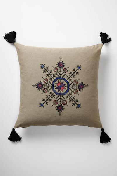 In this undated publicity photo released by Anthropologie.com, a Fesi pillow features a Moroccan design that echoes Scandinavian snowflake motifs. Pillows are a quick and easy way to introduce Scandinavian design elements. (AP Photo/Anthropologie.com)