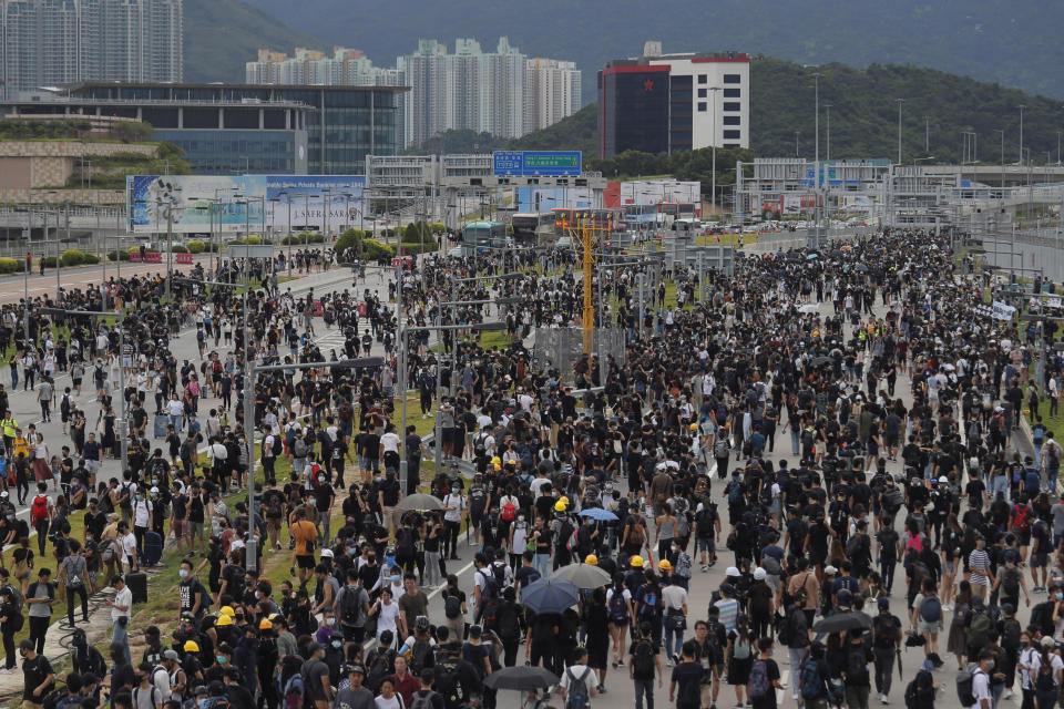 Pro-democracy protestors gather outside the airport in Hong Kong, Sunday, Sept. 1, 2019. The operator of the express train to Hong Kong's airport has suspended service as pro-democracy protesters gathered there following a day of violent clashes with police. Protesters gathered at the airport after online calls to disrupt travel. (AP Photo/Kin Cheung)