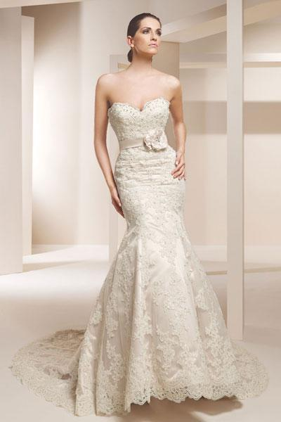 """<div class=""""caption-credit""""> Photo by: Claudine for Alyce</div><div class=""""caption-title"""">16. Claudine for Alyce</div>You can never go wrong with classic lace and a sweetheart neckline. Add a floral sash and you're ready for your wedding debut! <br> <br> Check out more gorgeous styles in our <a rel=""""nofollow noopener"""" href=""""http://www.bridalguide.com/photo-galleries/bridal-gowns/claudine-for-alyce-bridal/style-7826"""" target=""""_blank"""" data-ylk=""""slk:Claudine for Alyce gown gallery"""" class=""""link rapid-noclick-resp"""">Claudine for Alyce gown gallery</a>!"""