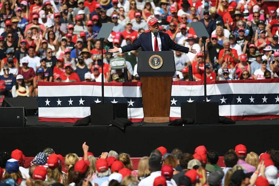 President Trump holds a rally in a parking lot at Raymond James Stadium in Tampa October 29. His plans for a Nov. 1 late-night rally in Opa-locka sets up a violation of Miami-Dade's midnight curfew if there isn't a change in the rules or his schedule.