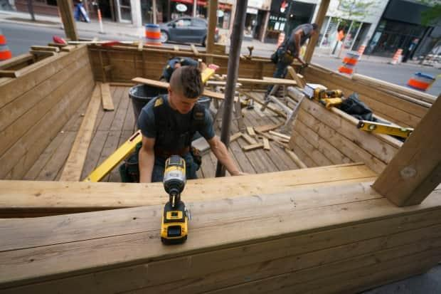 Montreal restaurants are hurriedly preparing their curbside decks and patios. The province has announced they can open on May 28. (Ivanoh Demers/Radio-Canada - image credit)