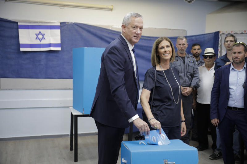 Blue and White party leader Benny Gantz and his wife Revital vote in Rosh Haayin, Israel, Tuesday, Sept. 17, 2019. Israelis began voting Tuesday in an unprecedented repeat election that will decide whether longtime Prime Minister Benjamin Netanyahu stays in power despite a looming indictment on corruption charges. (AP Photo/Sebastian Scheiner)