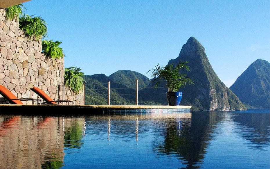 """Since 2012, <a rel=""""nofollow"""" href=""""http://www.travelandleisure.com/travel-guide/soufriere/hotels/jade-mountain"""">this iconic resort</a> has ranked as one of the top five resorts in the Caribbean: and for good reason. It's known for its killer views of the Piton Mountains (the location at the island's highest points helps), and its three-walled suites, the better from which to see the peaks. While it may be tempting to just relax in your private infinity pool, make sure to take advantage of the daily guided walks and hikes, watersports at sister property Anse Chastanet, and a sunset cruise on the resort's own yacht."""