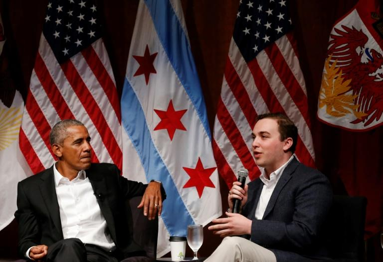 Former US president Barack Obama listens to Max Freedman during a forum with young leaders at the University of Chicago