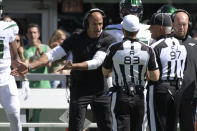 New York Jets head coach Robert Saleh, left, argues with referees during the first half of an NFL football game against the New England Patriots, Sunday, Sept. 19, 2021, in East Rutherford, N.J. (AP Photo/Bill Kostroun)