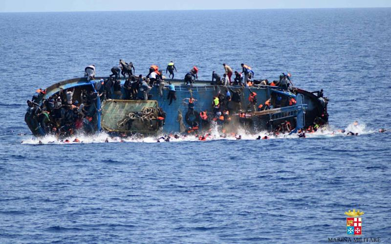 At least seven migrants have drowned after a heavily overcrowded boat they were sailing on overturned in May 2016 - Credit: AFP