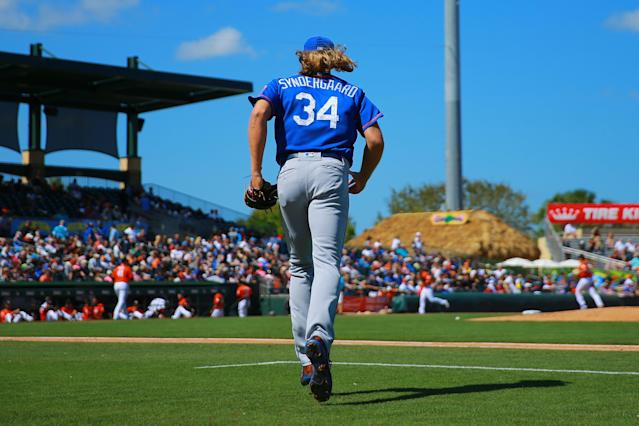 <p>New York Mets starting pitcher Noah Syndergaard (34) runs out on the field in the second inning of a baseball game against the Miami Marlins at Roger Dean Chevrolet Stadium in Jupiter, Fla., March 3, 2018. (Photo: Gordon Donovan/Yahoo News) </p>
