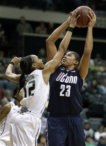South Florida guard Andrell Smith (12) blocks a shot by Connecticut forward Kaleena Mosqueda-Lewis (23) during the second half of an NCAA women's college basketball game Saturday, March 2, 2013, in Tampa, Fla. Mosqueda-Lewis scored 32 points in UConn's 85-51 win. (AP Photo/Chris O'Meara)