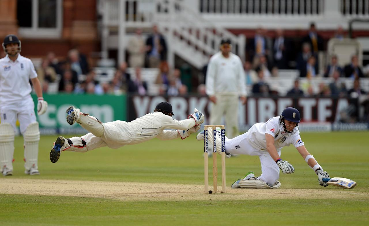 England's Joe Root (right) dives to avoid being run-out by New Zealand's Bradley-John Watling (left) during the first test at Lord's Cricket Ground, London.