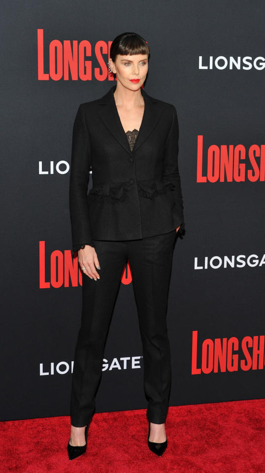 <p></p><p><span>Charlize Theron rocked a new fringe with a Dior suit at the 'Long Shot' premiere at the AMC Lincoln Square Cinema in New York. </span><em>[Photo: PA]</em> </p><p></p>