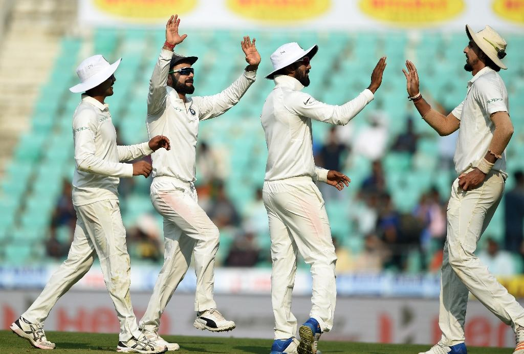 Indian cricket captain Virat Kohli (2nd L) celebrates with teammates during the first day of the second Test between India and Sri Lanka (AFP Photo/PUNIT PARANJPE)