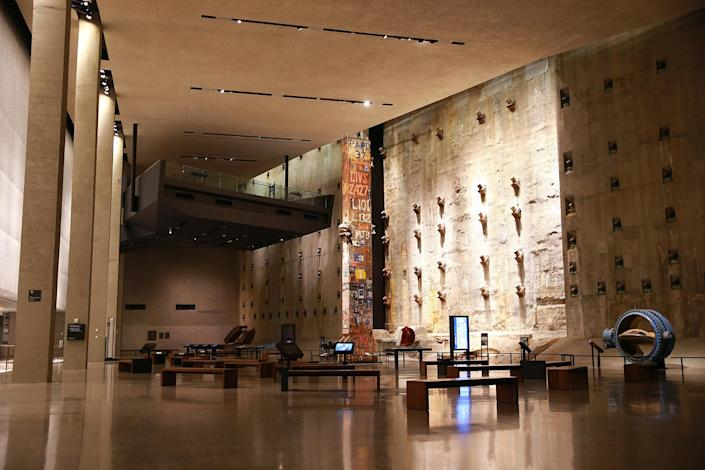 "<p>Foundation Hall is a room of massive scale, with ceilings ranging from 40 to 60 feet and nearly 15,000 square feet of floor space. Visitors see a portion of the slurry wall, a surviving retaining wall of the original World Trade Center that withstood the devastation of 9/11. Against this backdrop, the Last Column stands 36-feet high and is covered with mementos, memorial inscriptions and ""missing"" posters placed there by ironworkers, rescue workers and others. (Photo: Gordon Donovan/Yahoo News) </p>"