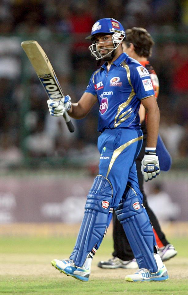 Rohit Sharma of Mumbai Indians celebrate his 50 during the CLT20 match between Perth Scorchers and Mumbai Indians at Feroz Shah Kotla, Delhi on Oct. 2, 2013. (Photo: IANS)