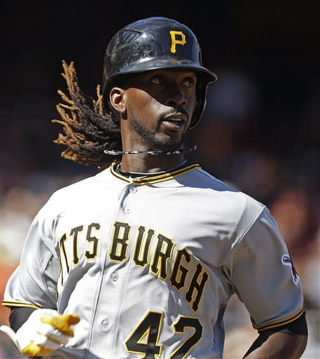 Pittsburgh Pirates' Andrew McCutchen scores on a bunt by Neil Walker during the eighth inning of a baseball game against the San Francisco Giants Sunday, April 15, 2012, in San Francisco. The Pirates won 4-1. (AP Photo/Ben Margot)
