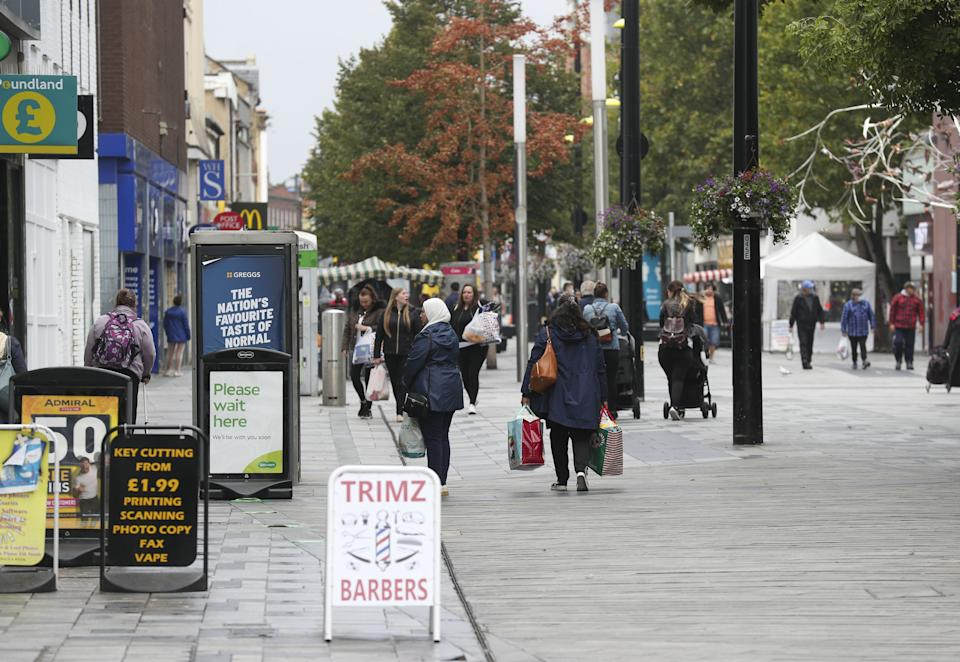 Shoppers on the High Street in Slough as the Berkshire town has been put back onto the government watch list because of a rise in coronavirus cases.