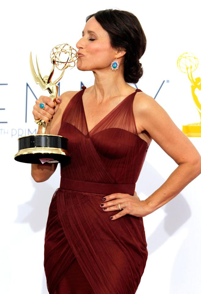 Julia Louis-Dreyfus poses in the press room at the 64th Primetime Emmy Awards at the Nokia Theatre in Los Angeles on September 23, 2012.