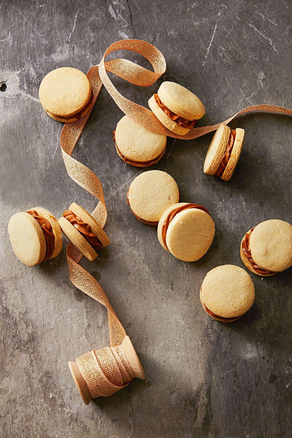 """<p>Dulce de leche is like caramel made from sweetened milk, so it's pretty much perfect on its own. Sandwich it between two buttery cookies and presto! You won the cookie swap.</p><p><em><a href=""""https://www.goodhousekeeping.com/food-recipes/dessert/a35757/dulce-de-leche-sandwiches/"""" rel=""""nofollow noopener"""" target=""""_blank"""" data-ylk=""""slk:Get the recipe for Dulce de Leche Sandwiches »"""" class=""""link rapid-noclick-resp"""">Get the recipe for Dulce de Leche Sandwiches »</a></em></p>"""