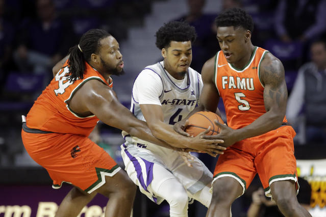 Florida A&M's Levi Stockard II (34) and Nasir Core (5) battle Kansas State's David Sloan (4) for the ball during the first half of an NCAA college basketball game Monday, Dec. 2, 2019, in Manhattan, Kan. (AP Photo/Charlie Riedel)
