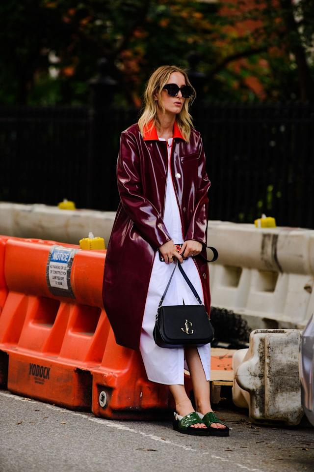 """<p>When you have on a statement coat, you can wear sweats underneath and no one will bat an eye. Now's the time to show off your favorite glossy trenches and teddy bear-inspired shearling jackets. A good fall coat is one investment piece you shouldn't skimp out on.<strong><br></strong></p><p><strong>Shop similar:<em> </em></strong><em><a href=""""https://www.net-a-porter.com/us/en/product/1130936/rains/glossed-pu-trench-coat"""" target=""""_blank"""">Rains glossed trench coat</a>, $208</em><strong></strong></p>"""