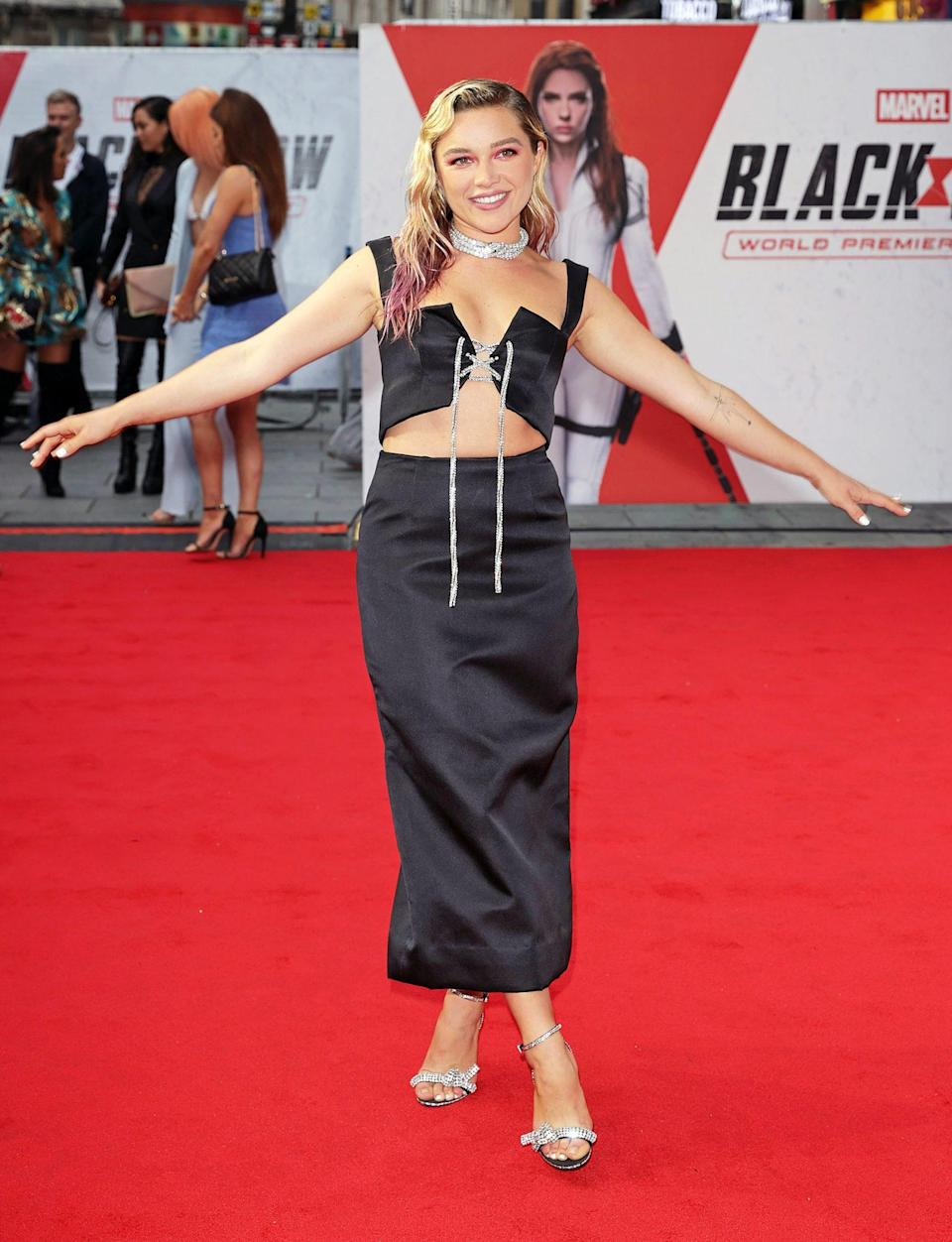 <p>Florence Pugh strikes a pose on the red carpet for <em>Black Widow </em>in London on June 29. </p>