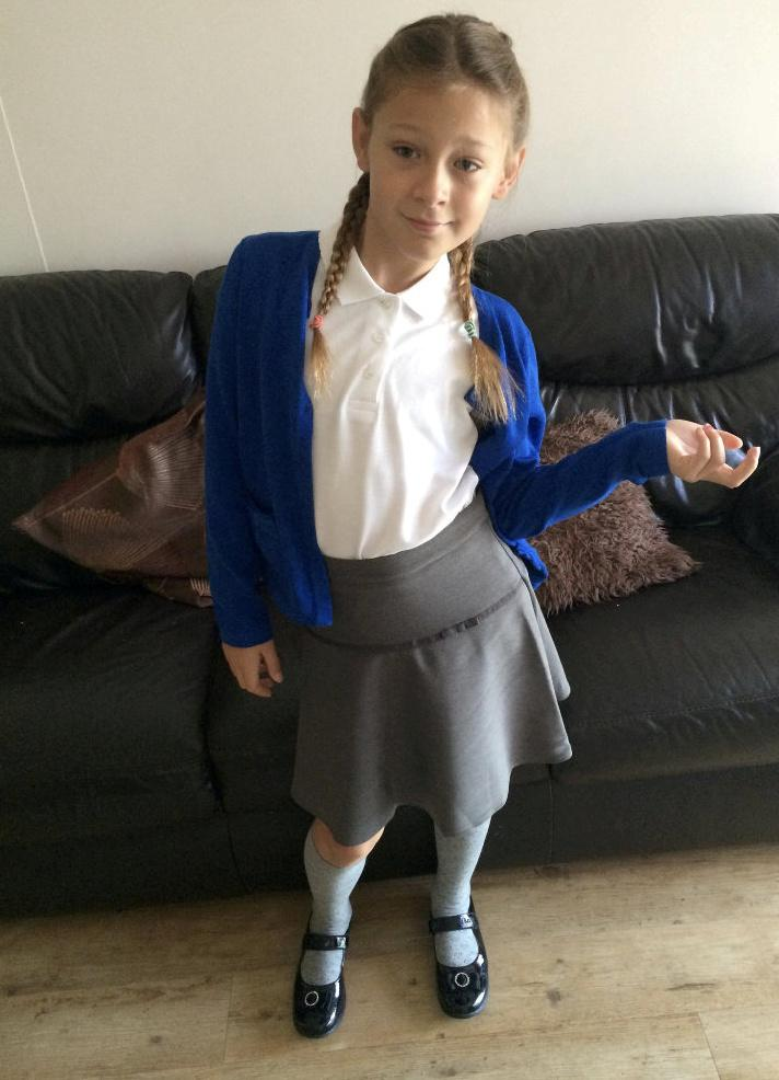 Ash was much happier when she could go to school dressed as a girl [Photo: SWNS]