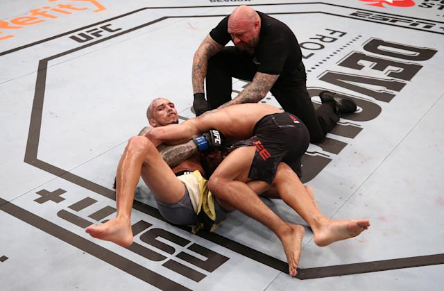 BRASILIA, BRAZIL - MARCH 14: (L-R) Charles Oliveira of Brazil secures a guillotine choke submission against Kevin Lee in their lightweight fight during the UFC Fight Night event on March 14, 2020 in Brasilia, Brazil. (Photo by Buda Mendes/Zuffa LLC)