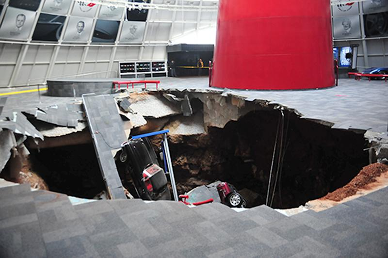 In this image provided by the National Corvette Museum shows several cars that collapsed into a sinkhole Wednesday, Feb. 12, 2014, in Bowling Green, Ky. The museum said a total of eight cars were damaged when a sinkhole opened up early Wednesday morning inside the museum. (AP Photo/National Corvette Museum, HO)