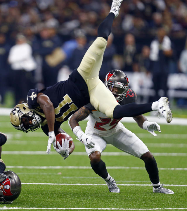 <p>New Orleans Saints returner Tommylee Lewis (11) is upended in front of Tampa Bay Buccaneers' Peyton Barber (25) in the first half of an NFL football game in New Orleans, Sunday, Sept. 9, 2018. (AP Photo/Butch Dill) </p>