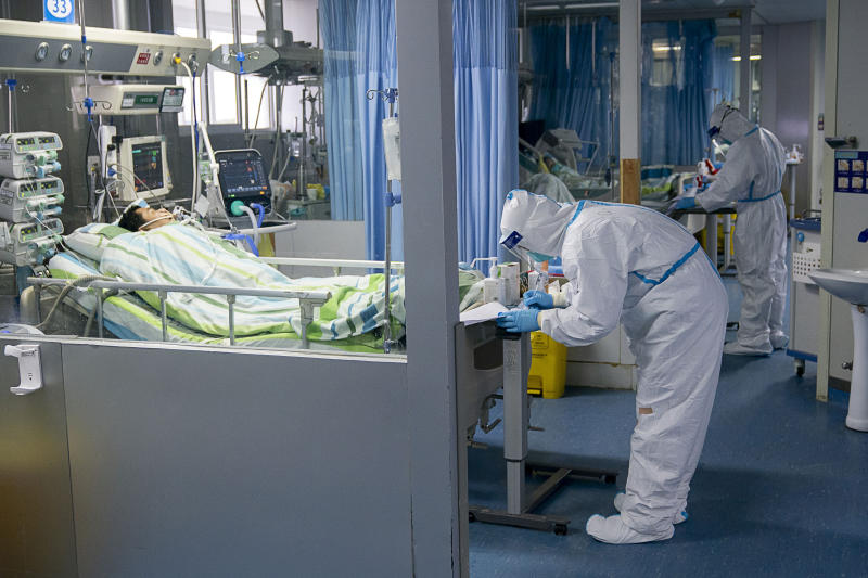 FILE - In this Jan. 24, 2020, file photo released by China's Xinhua News Agency, a medical worker attends to a patient in the intensive care unit at Zhongnan Hospital of Wuhan University in Wuhan in central China's Hubei Province. As Beijing instates one of the largest quarantines in modern history, locking down over 50 million people in Hubei province, questions are swirling around the provincial government's sluggish initial response. (Xiong Qi/Xinhua via AP, File)