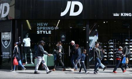 FILE PHOTO: People pass a JD Sports store in London, Britain, April 11, 2017. REUTERS/Neil Hall/File Photo