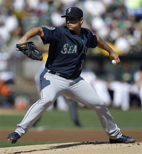 Seattle Mariners' Jason Vargas works against the Oakland Athletics in the first inning of a baseball game Saturday, Sept. 29, 2012, in Oakland, Calif. (AP Photo/Ben Margot)