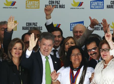 Colombia's President and presidential candidate Santos greets supporters during a campaign rally in Bogota