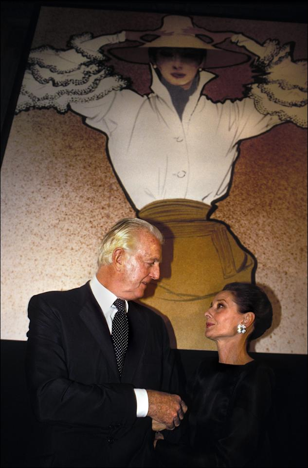 <p>Givenchy and Hepburn celebrate 40 years of Givenchy in Paris in 1991. (Photo: Pool BENAINOUS/DEVILLE/Gamma-Rapho via Getty Images) </p>