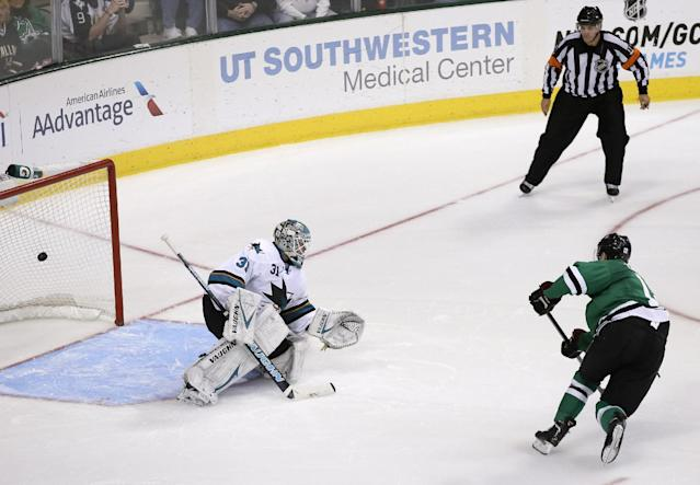 San Jose Sharks goalie Antti Niemi (31) of Finland defends as a shootout goal gets past him shot by Dallas Stars' Alex Chiasson (12) as referee Frederick L'Ecuyer, top, watches during an NHL hockey game, Thursday, Oct. 17, 2013, in Dallas. The Stars won on the shootout, 4-3. (AP Photo/Tony Gutierrez)