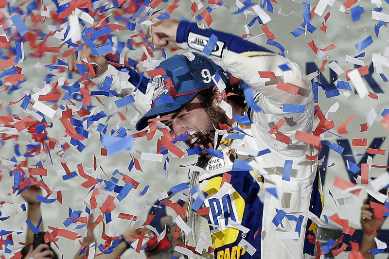 Chase Elliott celebrates in victory lane after winning the NASCAR Cup Series auto race at Charlotte Motor Speedway in Concord, N.C., Sunday, Sept. 29, 2019. (AP Photo/Gerry Broome)