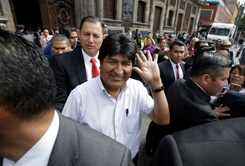 Bolivia's ousted president Evo Morales waves while heading to the town hall for a meeting with Mexico's City mayor Claudia Sheinbaum, in Mexico City