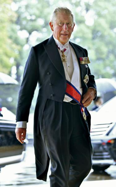 Britain's Prince Charles arrives for the Imperial Palace to attend the enthronement ceremony of Japan's Emperor Naruhito in Tokyo, Tuesday, Oct. 22, 2019.  Japan's Naruhito proclaimed himself Emperor during an enthronement ceremony at the Imperial Palace, declaring himself the country's 126th monarch.(Kyodo News via AP)