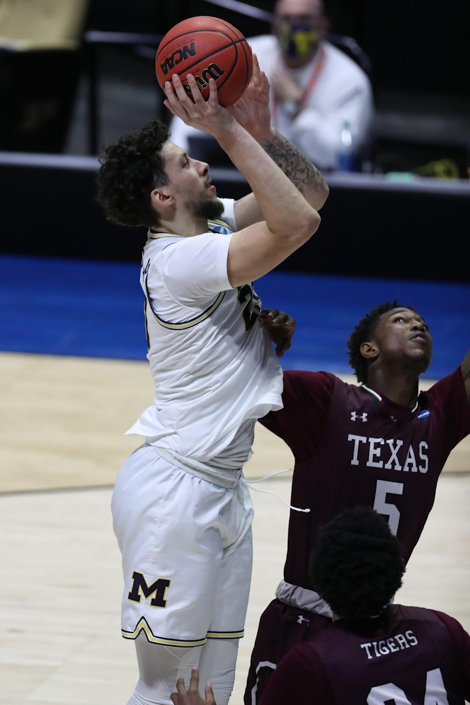 Michigan Wolverines forward Brandon Johns Jr. (23) shoots the ball against over Texas Southern Tigers forward John Walker III (24) and forward Joirdon Karl Nicholas (5) during the second half in the first round of the 2021 NCAA Tournament at Mackey Arena on March 20, 2021
