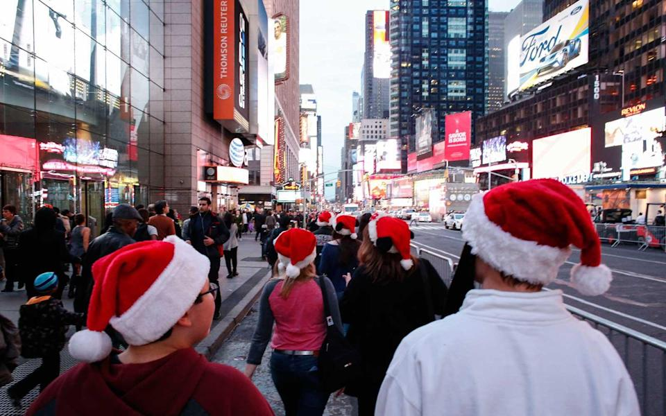 """<p>Times Square, often avoided by locals, has unique appeal around the holidays. There's nowhere else to take in the lights and the people, and really have no choice but to go with the hustling flow. And <a rel=""""nofollow noopener"""" href=""""https://www.amny.com/entertainment/elf-christmas-nyc-1.15439143"""" target=""""_blank"""" data-ylk=""""slk:as amNewYork so wonderfully explained"""" class=""""link rapid-noclick-resp"""">as <em>amNewYork</em> so wonderfully explained</a>, it's pretty easy — assuming you can suspend your fear of being judged — and cheap to enjoy midtown like <a rel=""""nofollow noopener"""" href=""""http://www.imdb.com/title/tt0319343/"""" target=""""_blank"""" data-ylk=""""slk:Buddy the """"Elf."""""""" class=""""link rapid-noclick-resp"""">Buddy the """"Elf.""""</a> So find a revolving door, enjoy the """"world's best"""" coffee, play hopscotch in a crosswalk (carefully), and have a holly, jolly Christmas.</p>"""