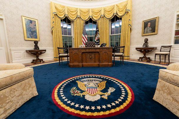 PHOTO: The Oval Office of the White House is newly redecorated for the first day of President Joe Biden's administration, Jan. 20, 2021, in Washington. New carpeting and drapes are some of the pictured changes. (Alex Brandon/AP)
