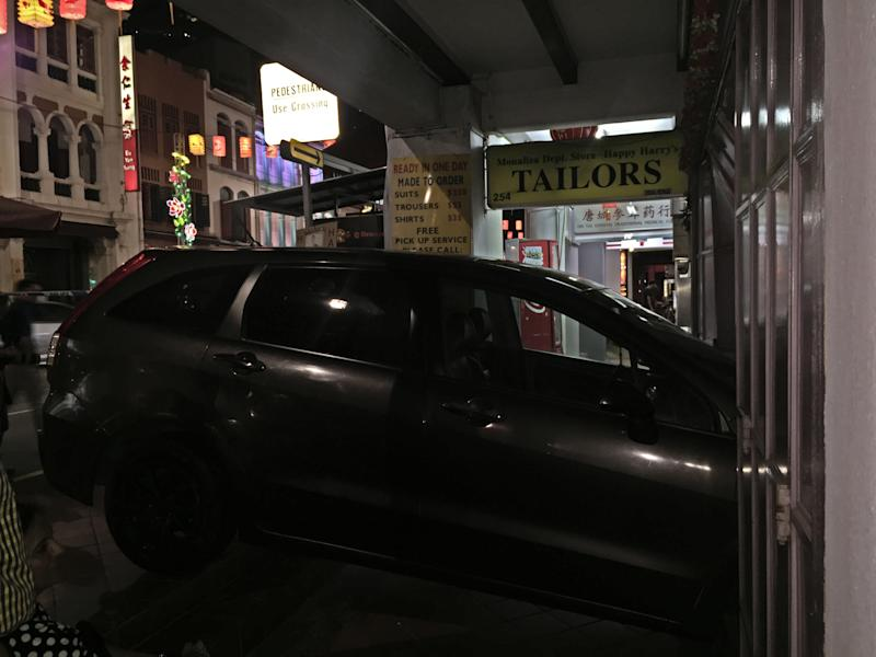 73c5a5396d458c A Honda Stream ploughed into a tailor shop front on South Bridge Road after  an accident
