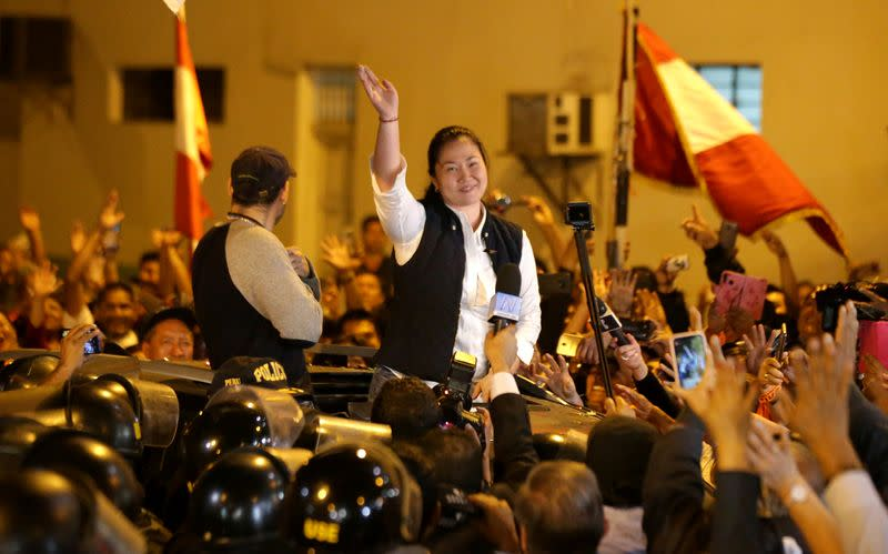 Peru's opposition leader Keiko Fujimori waves after being released from the Santa Monica prison, in Lima