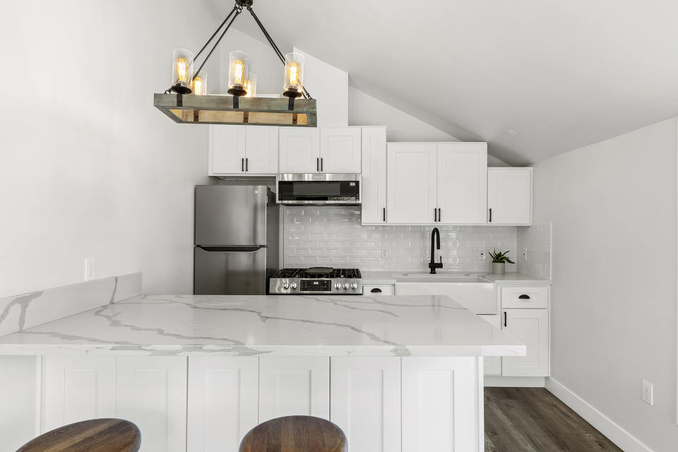 This marble-accented kitchen is in a 600-square-foot home built by Maxable in California.