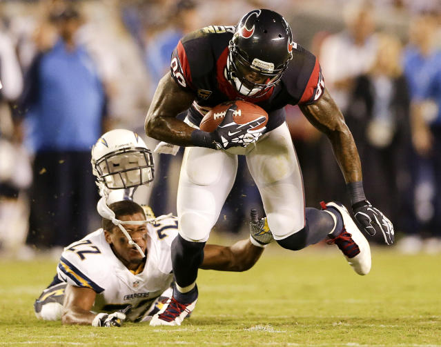 Houston Texans wide receiver Andre Johnson, right, breaks away from San Diego Chargers cornerback Derek Cox during the second half of an NFL football game Monday, Sept. 9, 2013, in San Diego. (AP Photo/Gregory Bull)